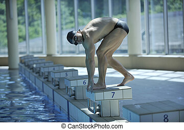 young swimmer ready for start