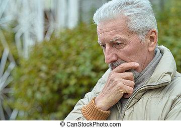 portrait of a senior man - close-up portrait of a senior man...