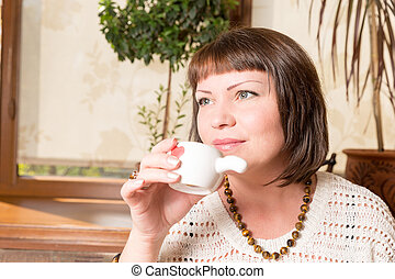 First sip. Portrait of a young woman drinking her morning...