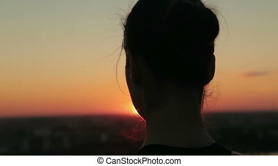 Sporty woman in lotus position in the park at sunset - 6...