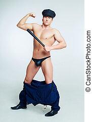 policeman, striptease costume - striptease dancer wearing...
