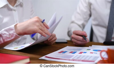 Checking Financial Report - The Secretary Gives A Check On...