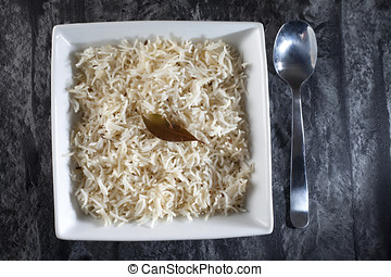 Basmati rice with classic long grains, cooked in Indian...