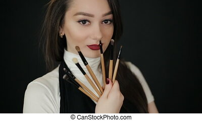 Woman with makeup brushes - Beautiful woman with makeup...