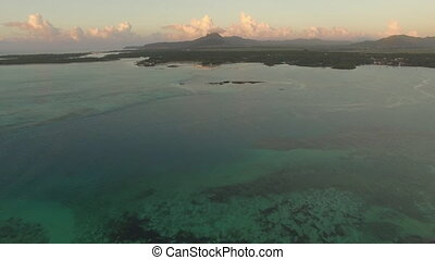 Aerial view of ocean blue water with waves, corals and water...