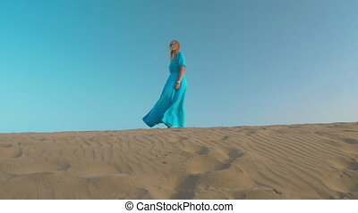 Woman beginning free life - Young woman on beach skyline...