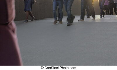 View of walking people legs at the street in daylight - View...