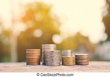 coin on old wood and tree bokeh background with sunlight, a...