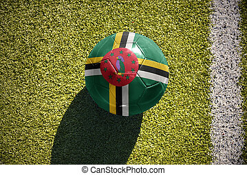 football ball with the national flag of dominica lies on the...