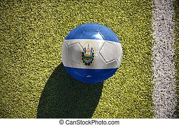 football ball with the national flag of el salvador lies on...