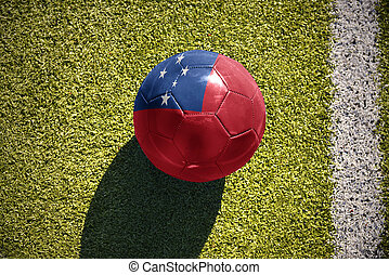 football ball with the national flag of Samoa lies on the...
