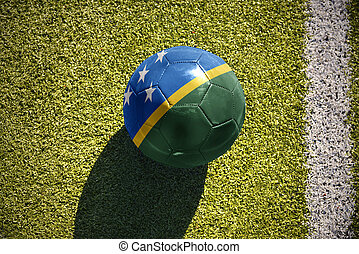 football ball with the national flag of Solomon Islands lies...
