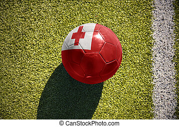 football ball with the national flag of Tonga lies on the...