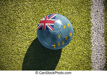 football ball with the national flag of Tuvalu lies on the...