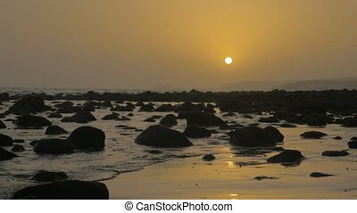 Coast with rocks at sunset