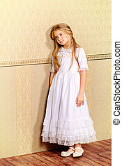 sad little girl - Sad little girl in a white dress leaning...