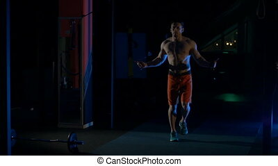 Man jumping skipping rope in the gym.