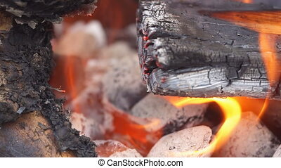 Close up of camp fire flames and fire Charcoal Stove burning...