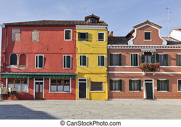 Colourfully painted houses on Burano island, Italy. -...