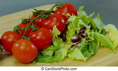 bell pepper, bacon, onions, tomatoes and lettuce, lying on a wooden stand