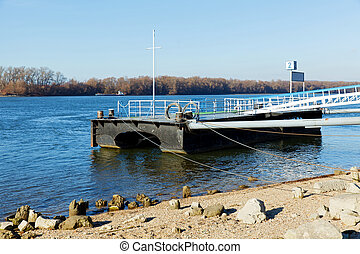 Dock on the river in winter sunlight - Picture of a dock by...