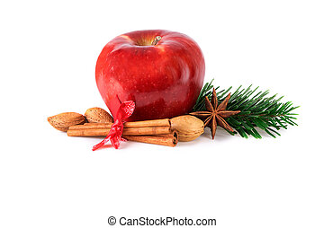 red christmas apple with spices ingredients on white