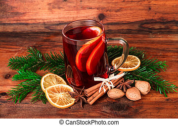 mulled wine with chritsmas spices over dark wood