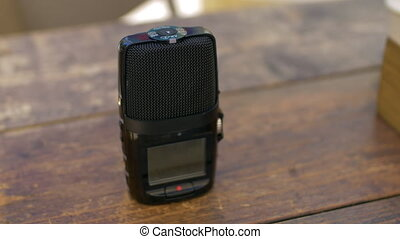 Recording dictaphone on cafe table - Close-up shot of a...
