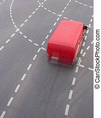 red minivan on city street