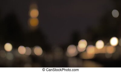 Defocused night city lights - Blurred warm light of night...