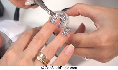 Manicure artist making professional manicure in spa salon -...