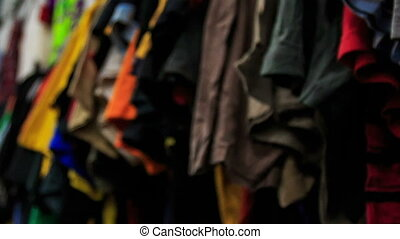 View of Racks with Colorful Women Clothes in Shop - closeup...