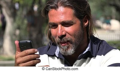 Attractive Man Using Smartphone