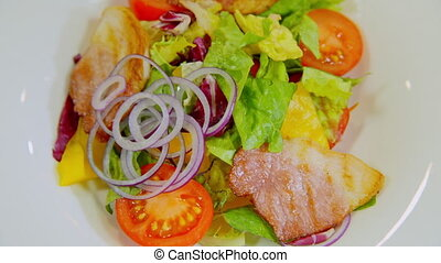 a plate of beautiful salad spinning