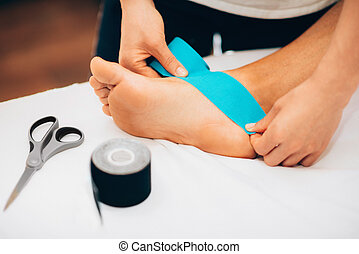 Kinesio Taping in Physical Therapy - Kinesio taping in...