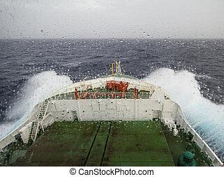 Ship cruising in heavy seas and rainy wheather