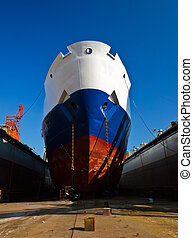 Ship on a dry dock - Ship waiting for repairs on a dry dock