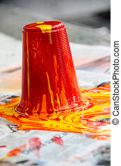 Paint pouring out and spilling on a paper