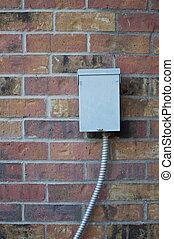 Electrical Box on Brick Wall - An electrical box on an outer...