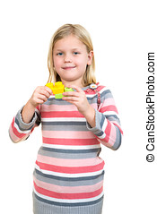 Little girl with a toy, Isolated on white
