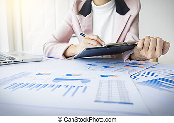 Portrait of business woman with laptop, finance graph and...