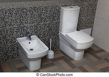 white toilet and bidet