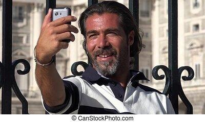 Man Taking Selfies Using Phone