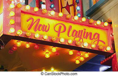 flashing sign at carnival - now playing at a theatre near...