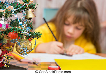 Carried away by a girl making Christmas crafts, focusing on...
