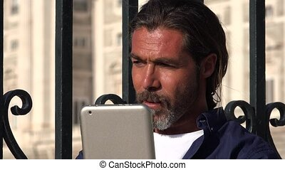 Confused Man Using Tablet Pc