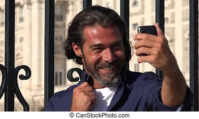 Man Taking Selfy Using Phone