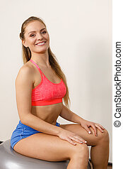 Woman in sportswear doing exercises with fit ball - Woman in...