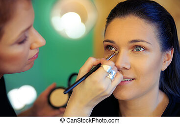 Makeup artist applying eyeshadow - Makeup artist stylist...