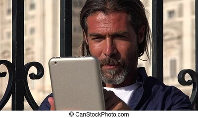 Man Using Tablet While Traveling